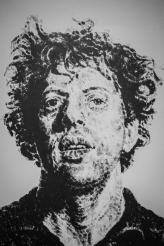 Awesome piece by Chuck Close made entirely with fingerprints.